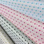4 different colours of polka dot tissue paper. Colours consist of pink, blue, black & gold